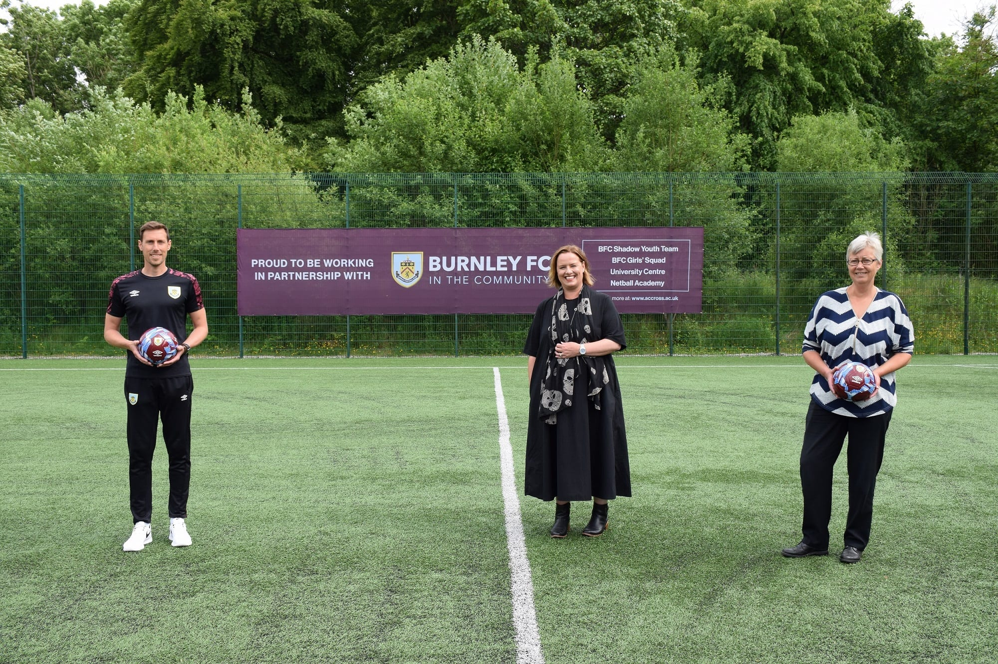 Chris Andrews and Dr Sara Ward, from Burnley FC in the Community, with Charlotte Scheffmann, Dean of Higher Education at Nelson and Colne College University Centre